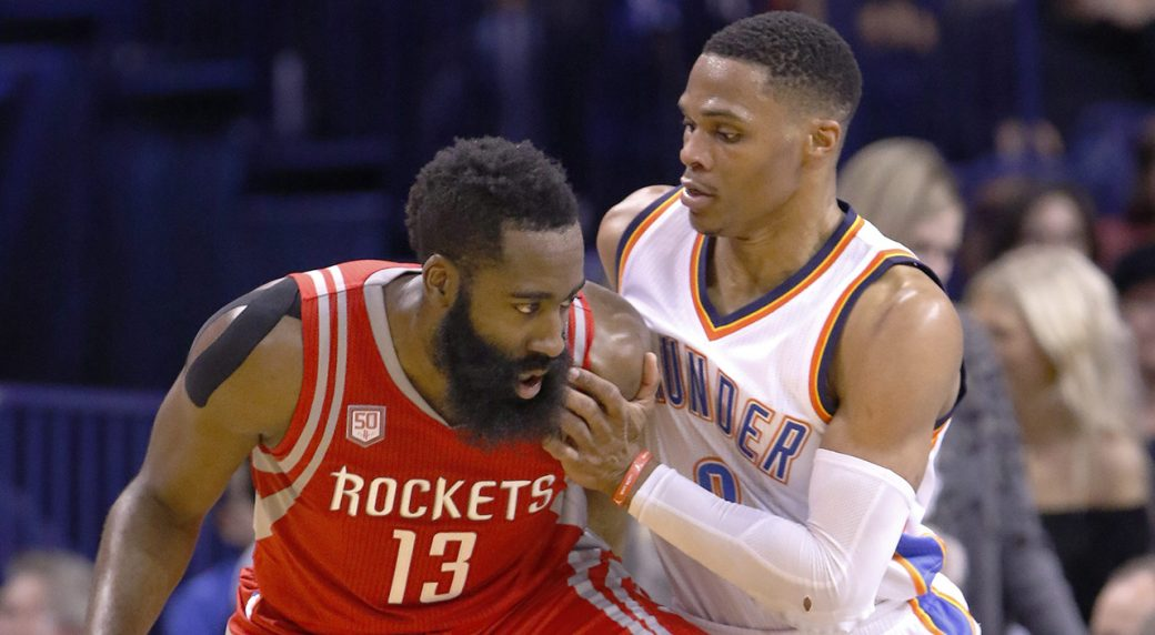 5e024897f3c Houston Rockets guard James Harden (13) is defended by Oklahoma City Thunder  guard Russell Westbrook (0) on a drive to the basket during the second half  of ...