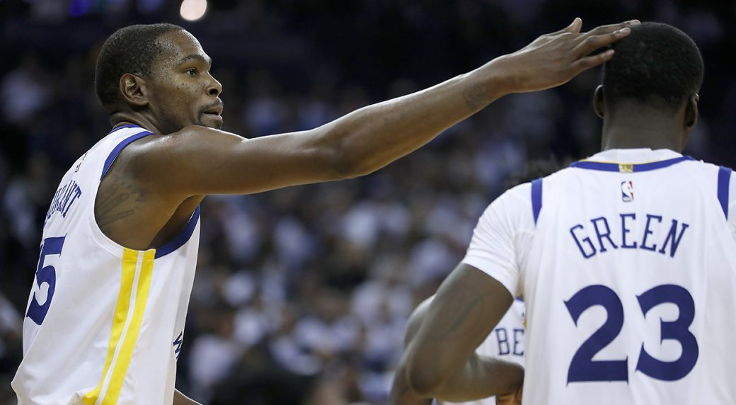 1c8951cf178 Golden State Warriors forward Kevin Durant (35) taps forward Draymond Green  (23) on the head after scoring against the Cleveland Cavaliers during the  second ...