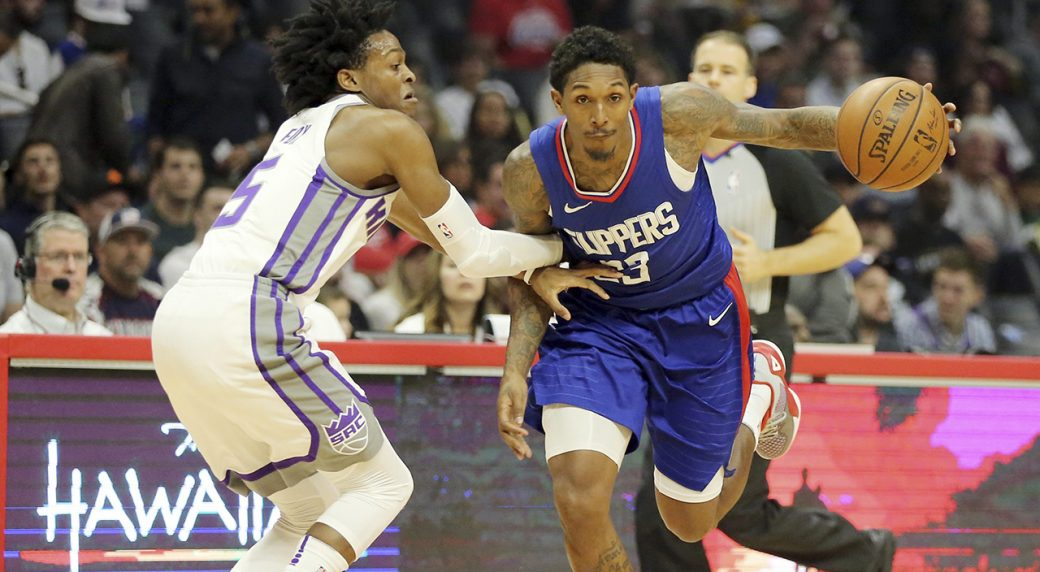 bbfcf4d67 Sacramento Kings guard De Aaron Fox (5) defends as Los Angeles Clippers  guard Lou Williams (23) drives in the first period of an NBA basketball  game in Los ...