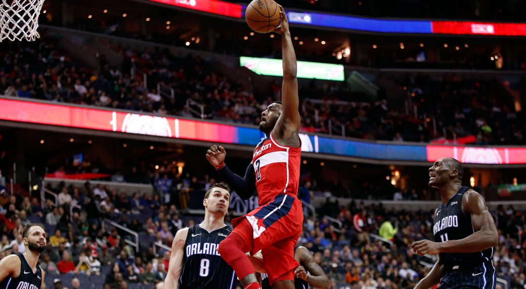 Washington Wizards Guard John Wall 2 Goes Up For A Dunk In Front Of Orlando Magic Forward Evan Fournier 10 Mario Hezonja 8 And Center Bismack