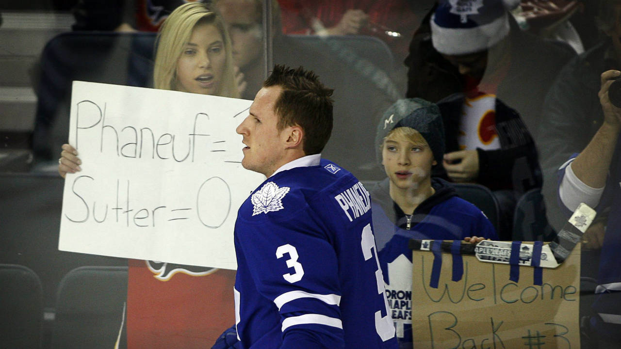 Dion Phaneuf skates past fans during a warmup ahead of his first game back in Calgary.