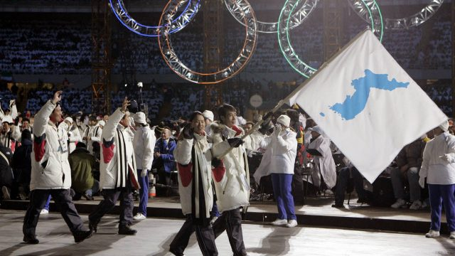 In-this-Feb.-10,-2006,-file-photo,-Korea-flag-bearer's-Bora-Lee-and-Jong-In-Lee,-carrying-a-unification-flag-lead-their-teams-into-the-stadium-during-the-2006-Winter-Olympics-opening-ceremony-in-Turin,-Italy.-North-Korea-plans-to-send-a-spotlight-stealing-delegation-to-next-month's-Winter-Olympics-in-the-South-Korean-county-of-Pyeongchang.-(Amy-Sancetta,-File/AP)