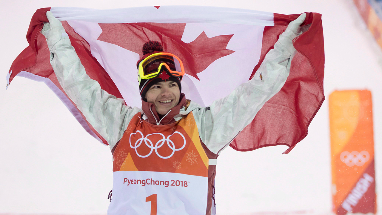 Canadian Mikael Kingsbury celebrates winning his gold medal in the moguls finals at the Pyeongchang 2018 Winter Olympic Games