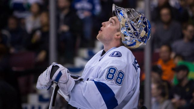 Tampa-Bay-Lightning-goaltender-Andrei-Vasilevskiy-(88)-reacts-after-making-a-save-against-the-Vancouver-Canucks-during-second-period-NHL-hockey-action-in-Vancouver-on-Saturday,-February-3,-2018.-(Ben-Nelms/CP)