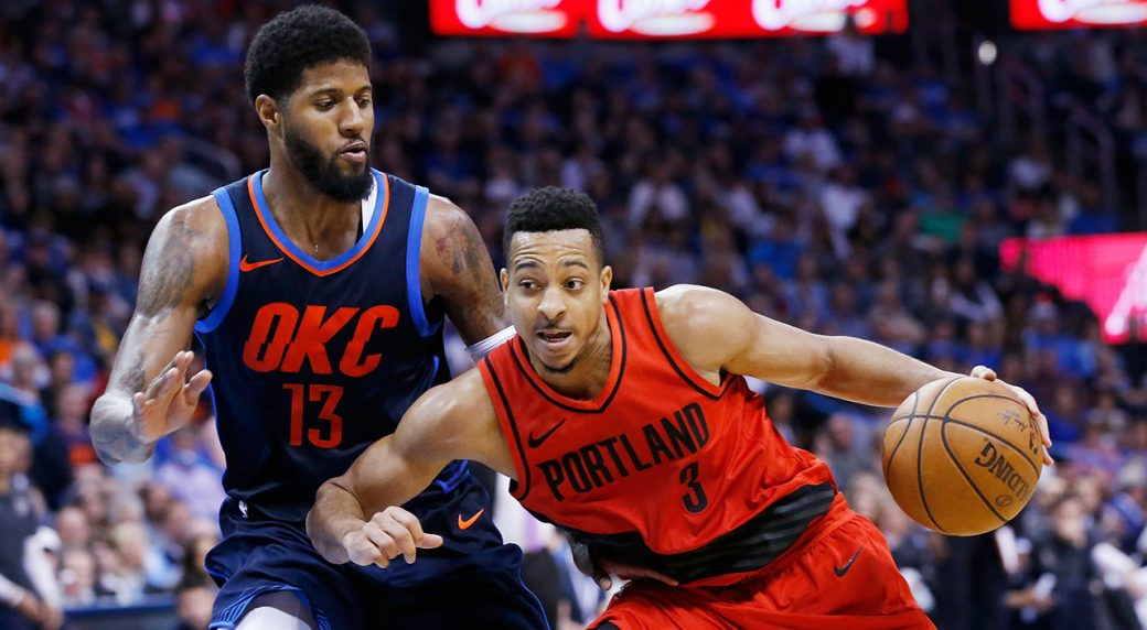 47b3b15e2b0 Portland Trail Blazers guard C.J. McCollum (3) drives around Oklahoma City  Thunder forward Paul George (13) in the second half of an NBA basketball  game in ...
