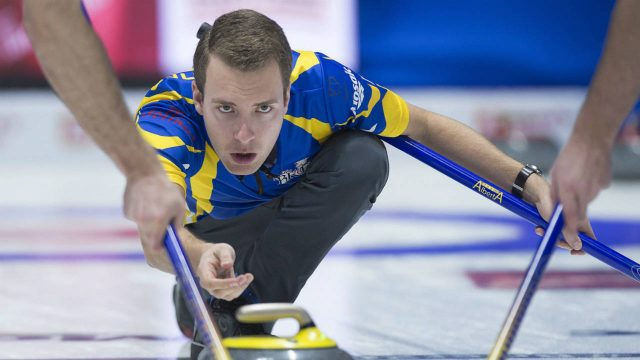 Alberta-skip-Brendan-Bottcher-delivers-a-rock-as-they-play-Northwest-Territories-at-the-Tim-Hortons-Brier-curling-championship-at-the-Brandt-Centre-in-Regina-on-Sunday,-March-4,-2018.-(Andrew-Vaughan/CP)