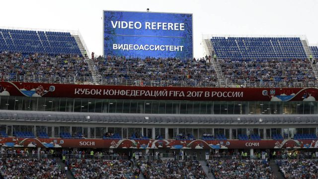 In-this-Sunday,-June-25,-2017-file-photo,-a-giant-screen-reports-an-incident-is-being-investigated-by-VAR-(Video-Assistant-Referee)-during-the-Confederations-Cup,-Group-B-soccer-match-between-Germany-and-Cameroon,-at-the-Fisht-Stadium-in-Sochi,-Russia.-Football's-rules-making-panel-is-advising-FIFA-to-approve-video-review-technology-for-referees-before-the-World-Cup.-The-panel,-known-as-IFAB,-says-its-technical-experts-made-the-recommendation-Monday,-Jan.-22,-2018-ahead-of-a-March-2-meeting-at-FIFA-which-can-decide.-(Thanassis-Stavrakis,-file/AP)