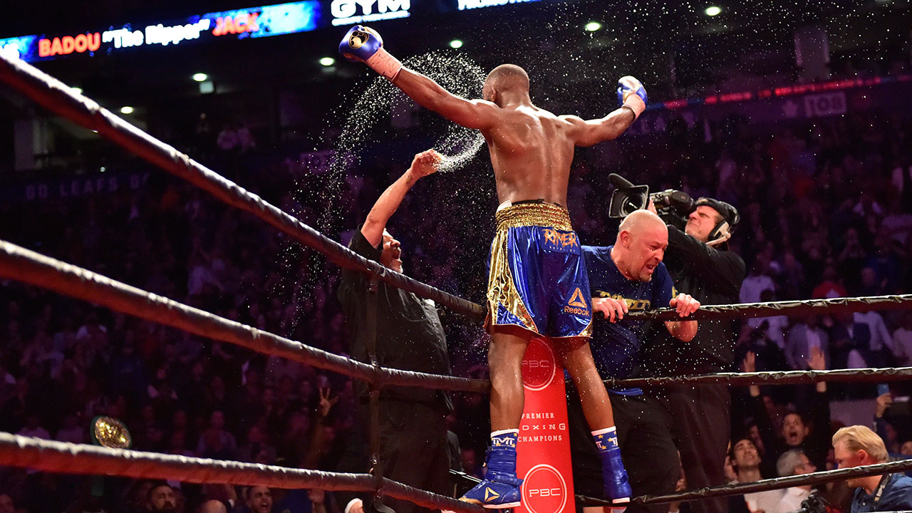 Trainers throw water on their fighter Badou Jack after his WBC light-heavyweight championship boxing match against Adonis Stevenson at Air Canada Centre in Toronto.