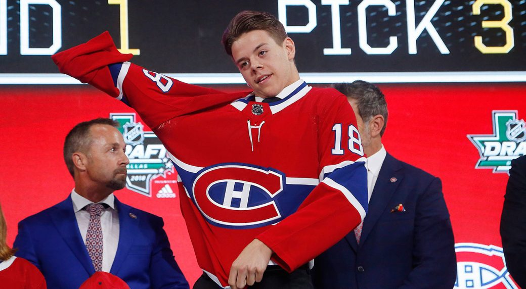 Jesperi-Kotkaniemi-dons-a-Montreal-Canadiens-jersey-after-being-chosen-third-overall-in-the-2018-NHL-Draft