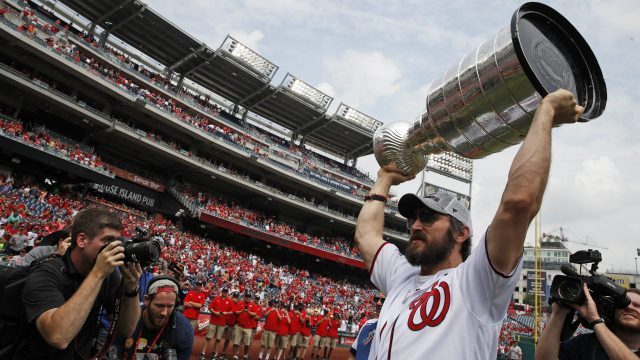Washington-Capitals'-Alex-Ovechkin,-from-Russia,-lifts-the-Stanley-Cup-on-the-field-before-a-baseball-game-between-the-Washington-Nationals-and-the-San-Francisco-Giants-at-Nationals-Park,-Saturday,-June-9,-2018,-in-Washington.-(Alex-Brandon/AP)