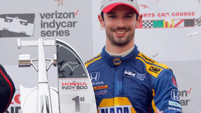 alexander_rossi_poses_with_his_trophy