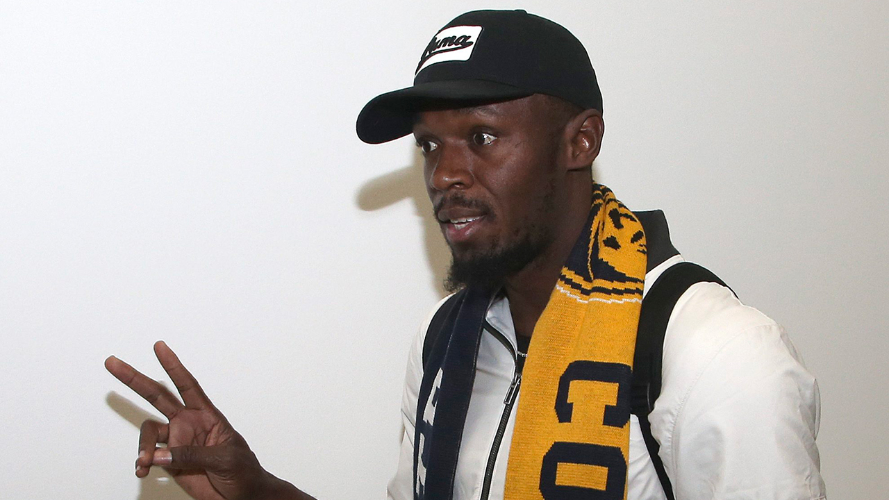 Usain Bolt arrives for try out in Australian soccer's A-League