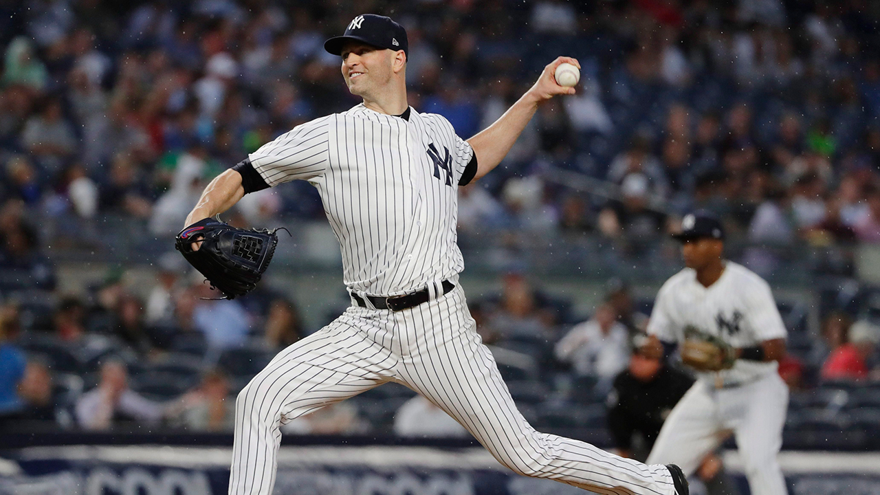 Yankees-ja-happ-delivers-pitch-against-rays