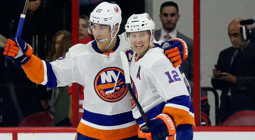 8ac65a52244 New York Islanders' Josh Bailey (12) and Anders Lee (27) celebrate Bailey's  game-winning goal in overtime during an NHL hockey game against the  Carolina ...