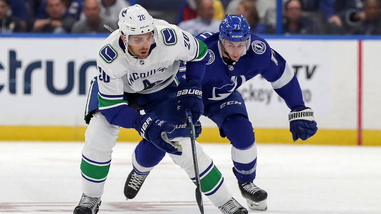 Canucks rally for 4 goals in third to stun Lightning