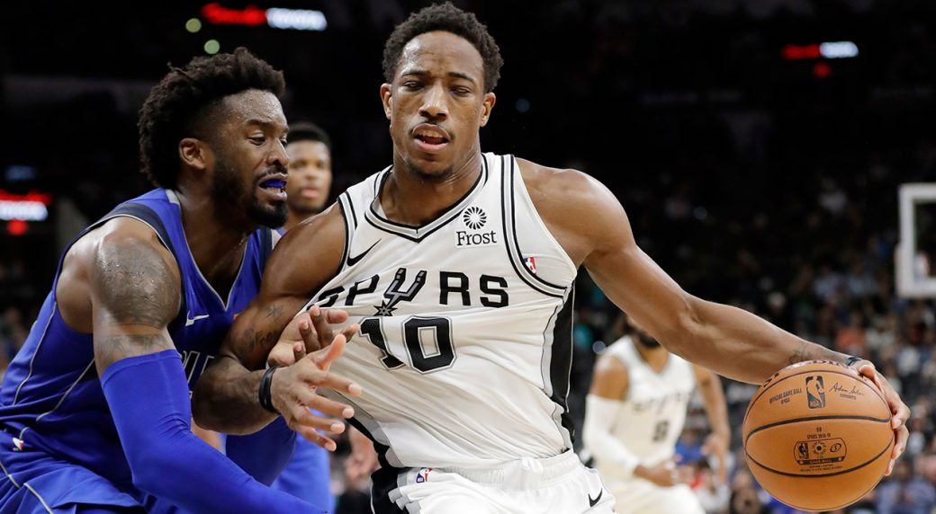 DeRozan outduels Doncic, Spurs beat Mavs in OT 113-108