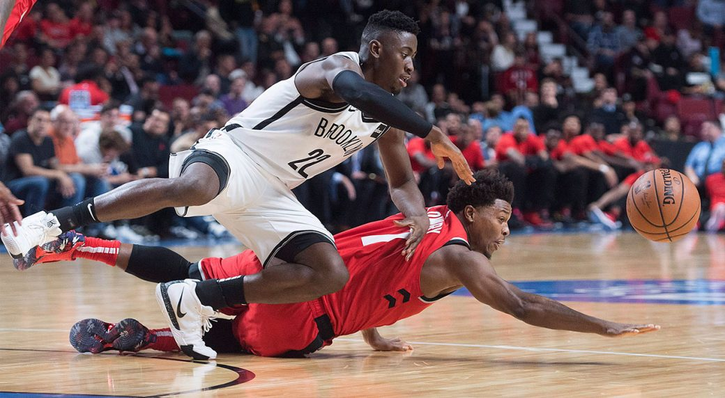 NBA-Lowry-dives-for-loose-ball