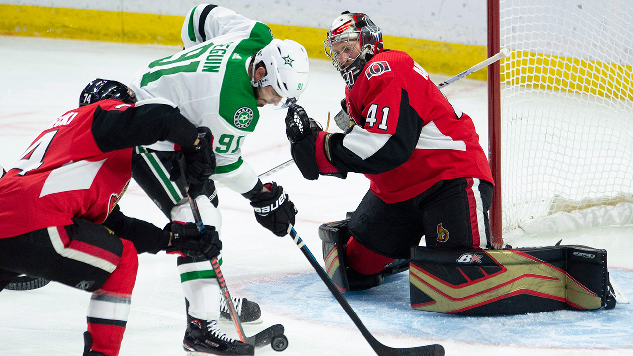 Nhl-senators-anderson-makes-save-against-stars
