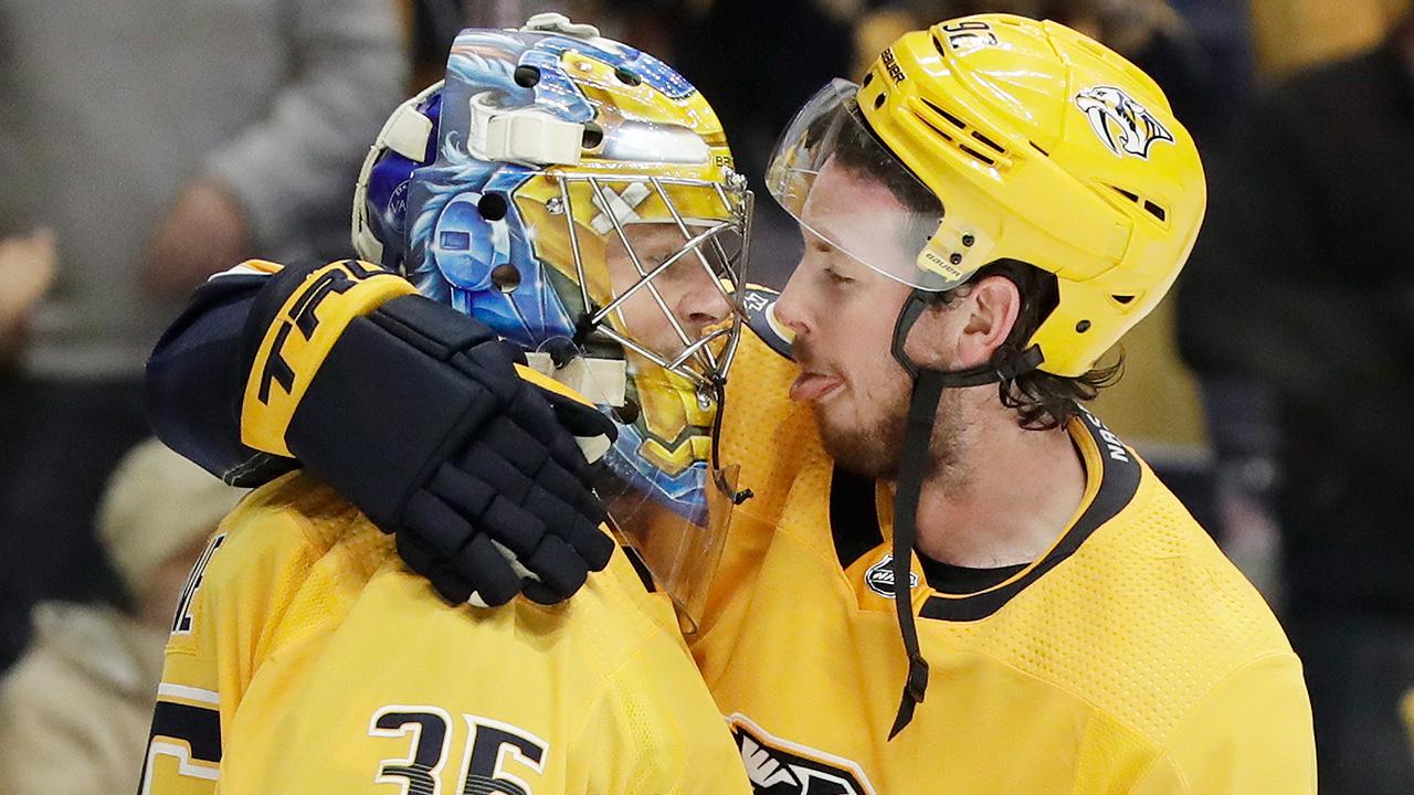 Nhl-hockey-predators-johansen-and-rinne-celebrate-win-over-wild