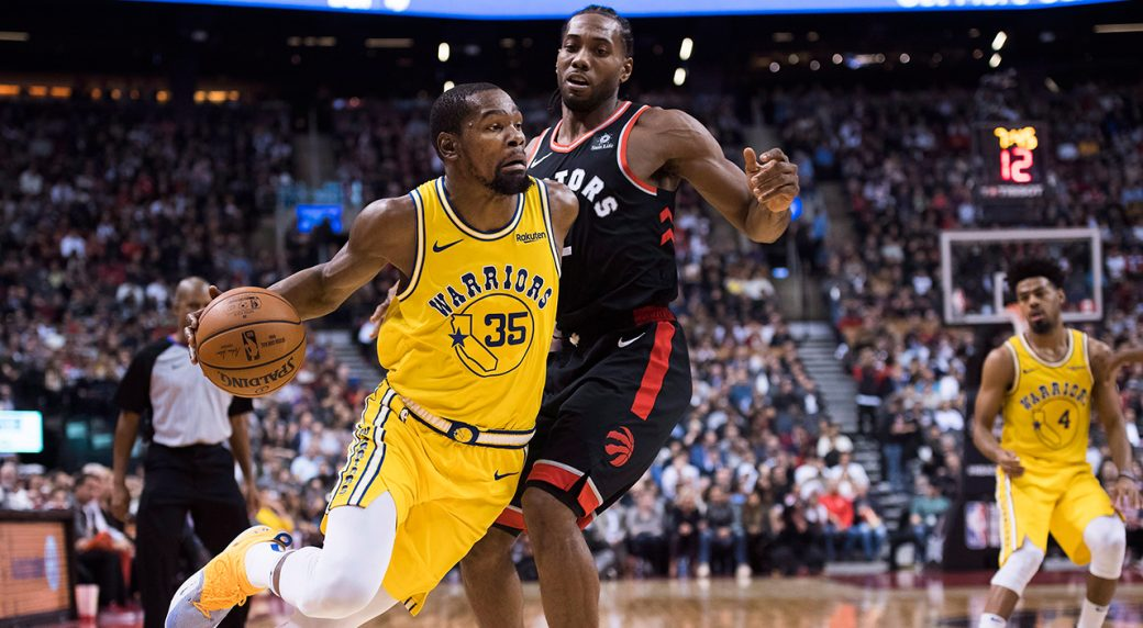 b4b104872d9 Golden State Warriors  Kevin Durant drives around Toronto Raptors  Kawhi  Leonard. (Nathan Denette CP)