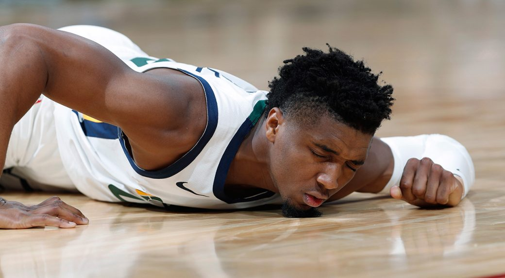ce8127682f92 Utah Jazz guard Donovan Mitchell reacts after being injured against the  Memphis Grizzlies. (David Zalubowski AP)