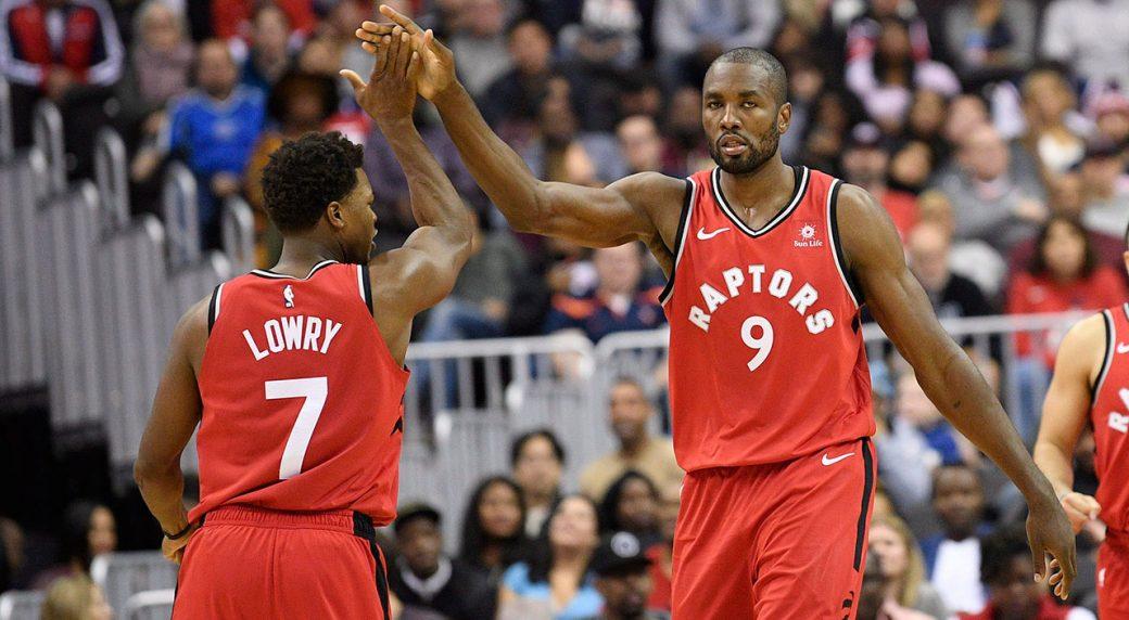 Toronto Raptors forward Serge Ibaka (9) gets a high five from guard Kyle  Lowry (7). (Nick Wass AP) 0a4f7e9e3