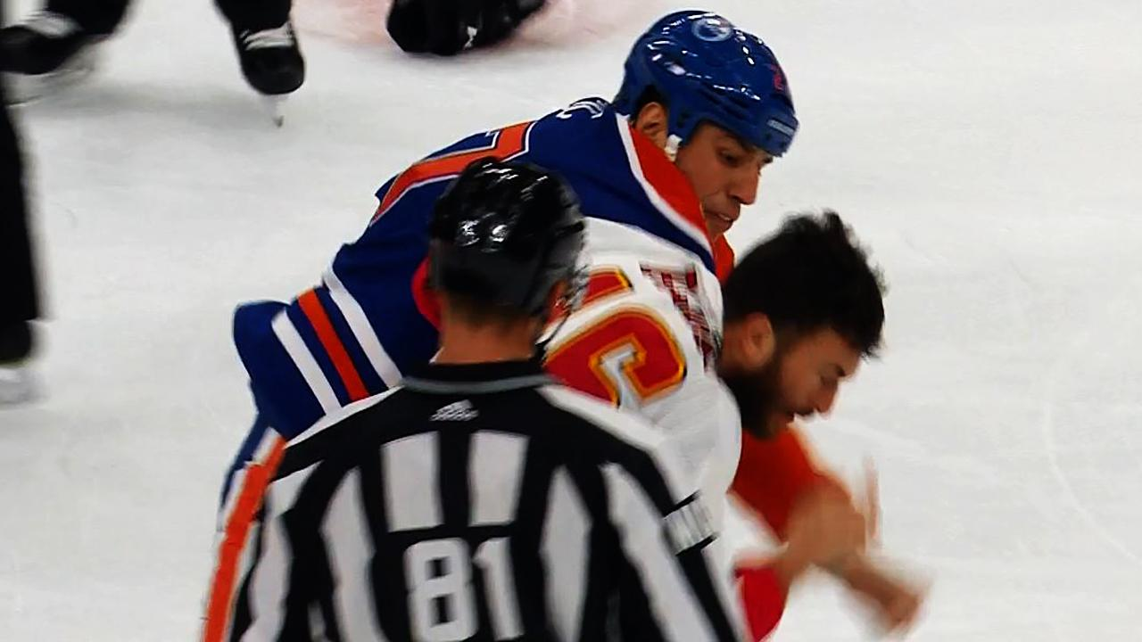 Lucic levels Hamonic then dukes it out with Peluso