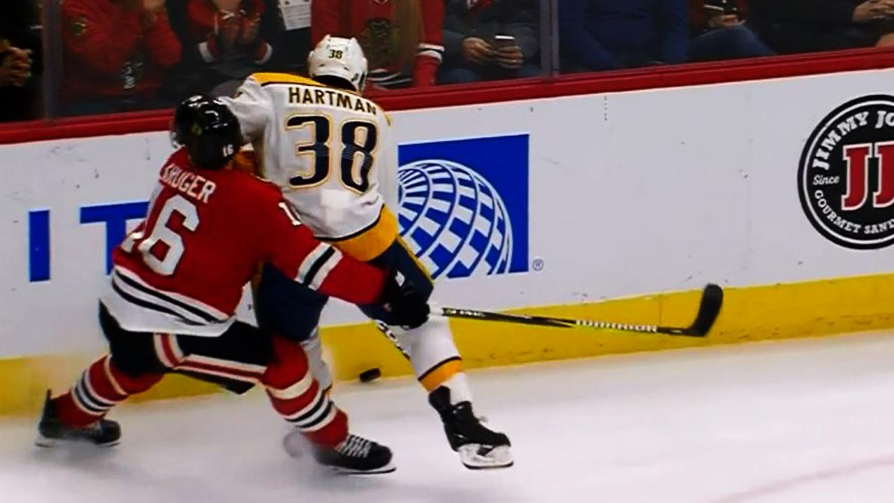 Kruger goes down after taking Hartman's elbow directly to face