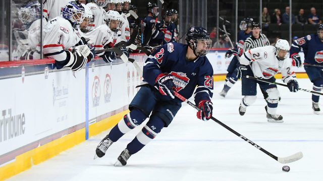Jack-Hughes-brings-the-puck-up-during-the-USA-Hockey-All-American-Prospects-Game