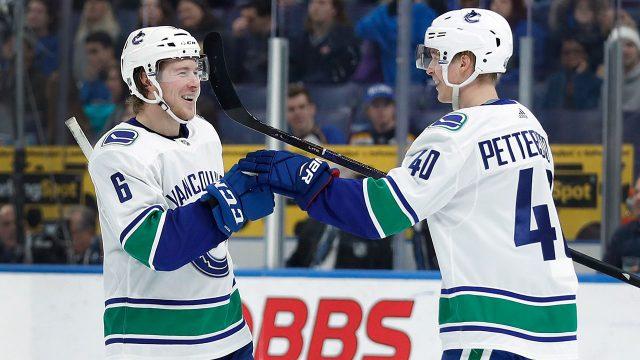NHL-Canucks-Pettersson-celebrates-Boeser-goal-against-Blues