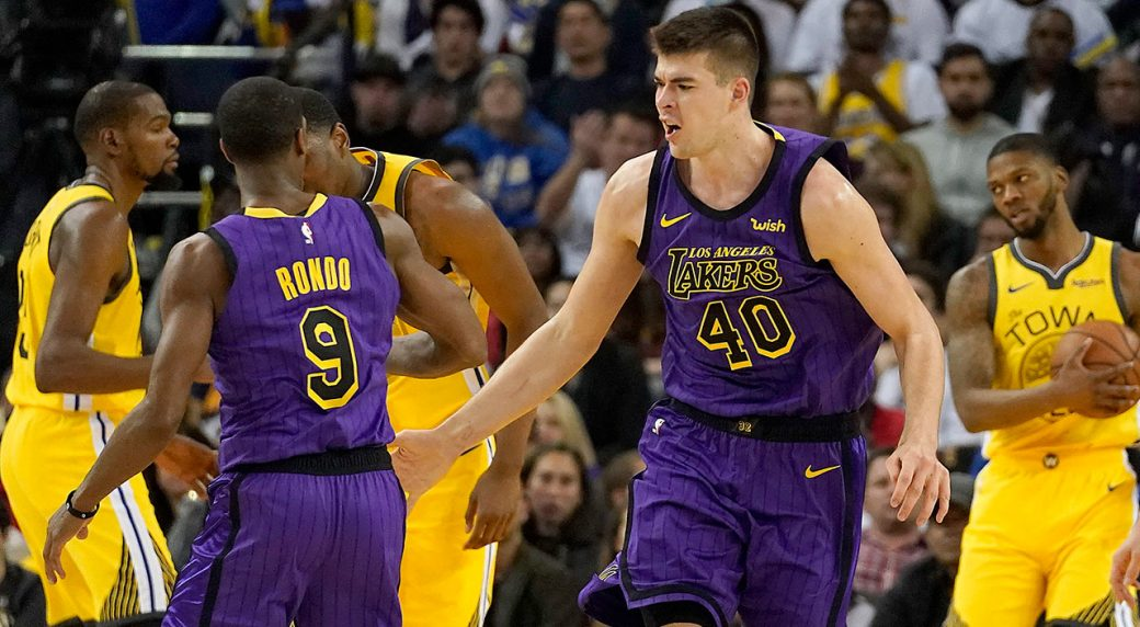 b01458bcf70 Lakers rout Warriors despite losing LeBron James to injury ...
