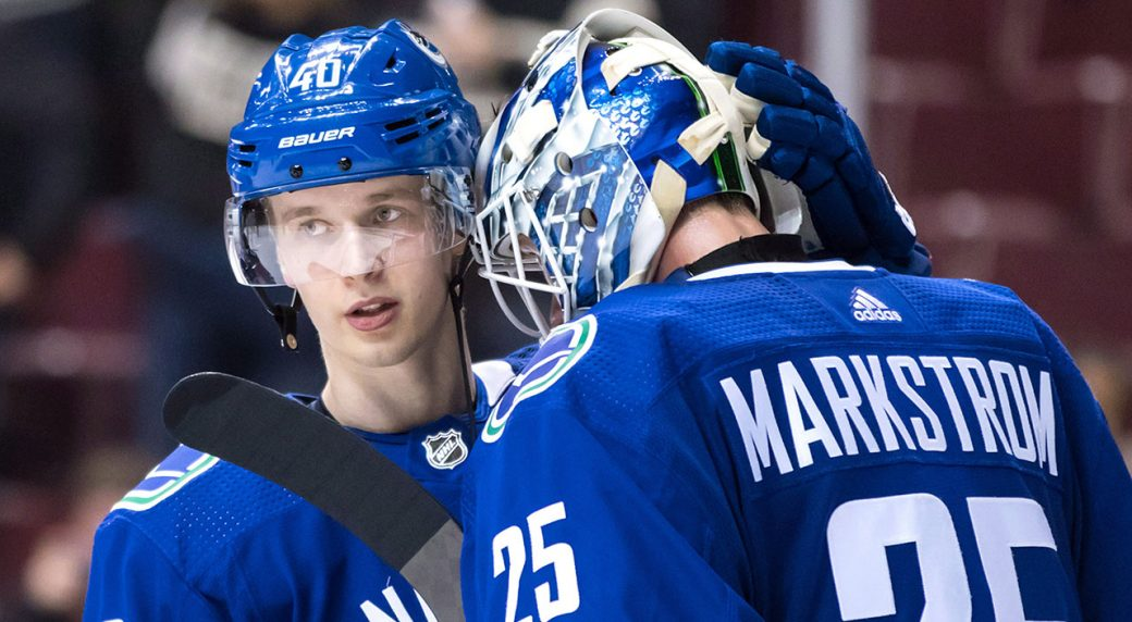 Canucks-Pettersson-congratulates-Markstrom-after-win