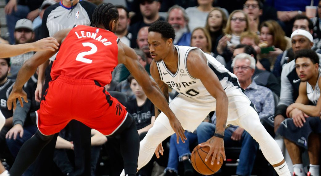 bd504d3c9068 The San Antonio Spurs  DeMar DeRozan is guarded by the Toronto Raptors   Kawhi Leonard. (Ronald Cortes Getty Images)