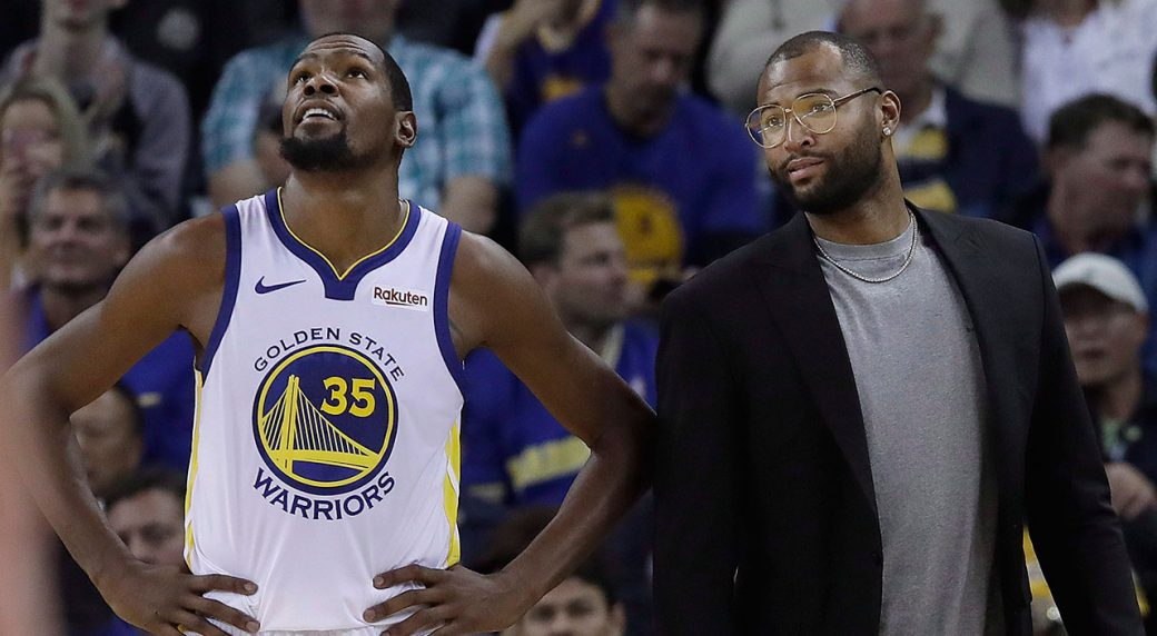 Golden State Warriors forward Kevin Durant (35) stands on the sideline with DeMarcus  Cousins during the second half of an NBA basketball game against the ... 56c8655c8