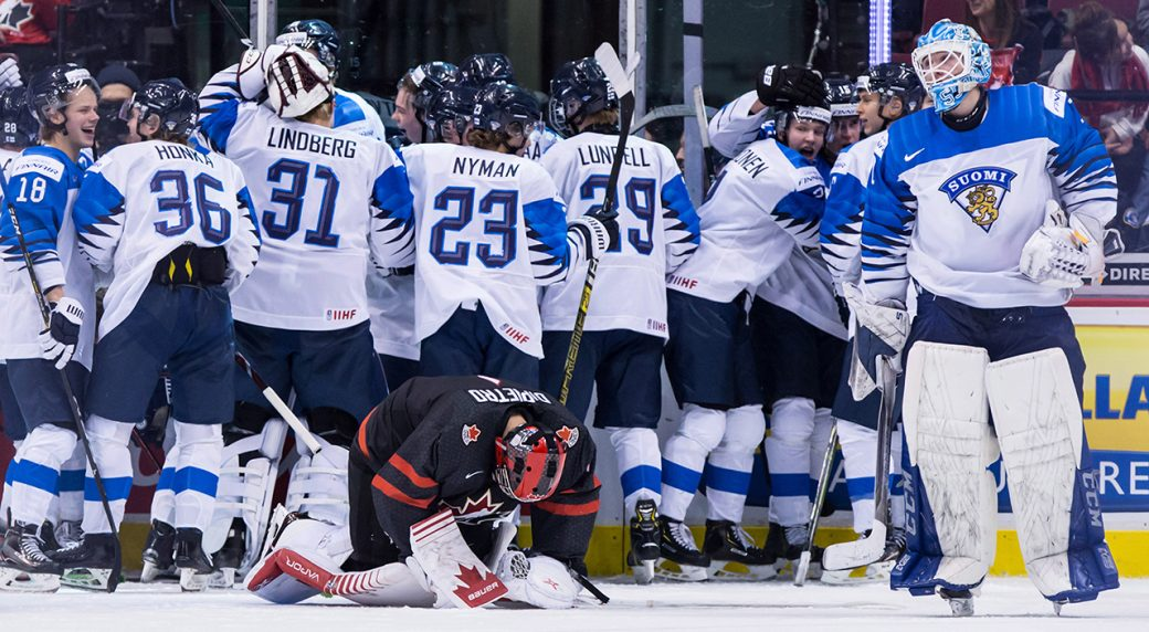 Russia beats Canada to wrap up Group A in world junior hockey