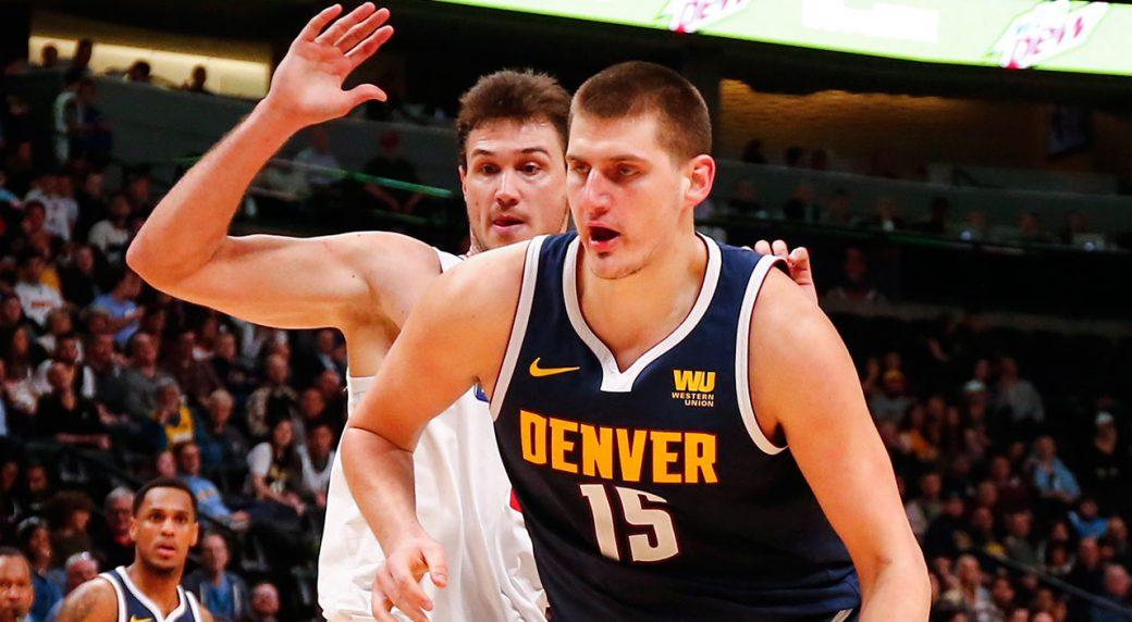 NBA-Nuggets-Jokic-drives-past-Clippers-Gallinari