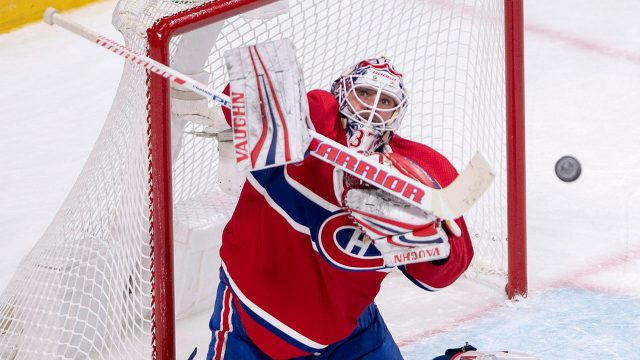 NHL-Canadiens-Niemi-stops-puck-against-Panthers