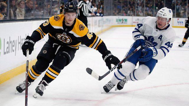 NHL-Maple-Leafs-Rielly-skates-next-to-Bruins-Heinen