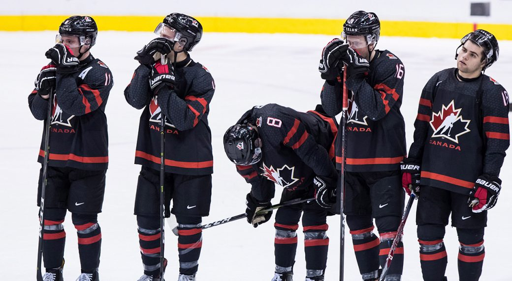 Canada's Shane Bowers, from left to right, Jared McIsaac, Cody Glass,  MacKenzie Entwistle and Markus Phillips look on after losing to Finland in  the ...