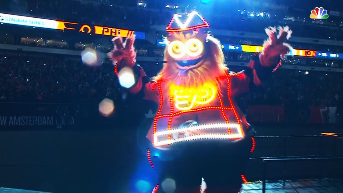 Getting' Gritty With It. Flyers' Mascot Makes Grand Entrance To Start Stadium Series Game