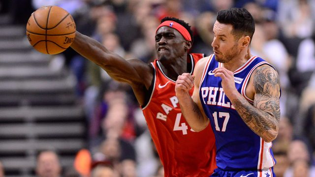 NBA-Raptors-Siakam-reaches-for-ball-against-76ers