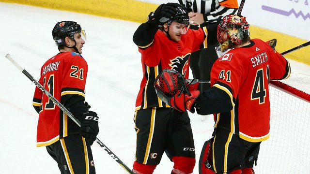 NHL-Flames-Andersson-celebrates-win-with-Smith
