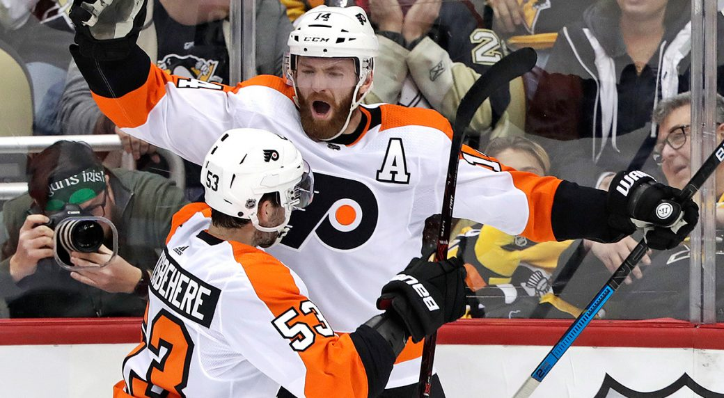 086362de4b2 Philadelphia Flyers' Sean Couturier (14) celebrates with Shayne  Gostisbehere (53) after getting the game-winning goal past Pittsburgh  Penguins goaltender ...