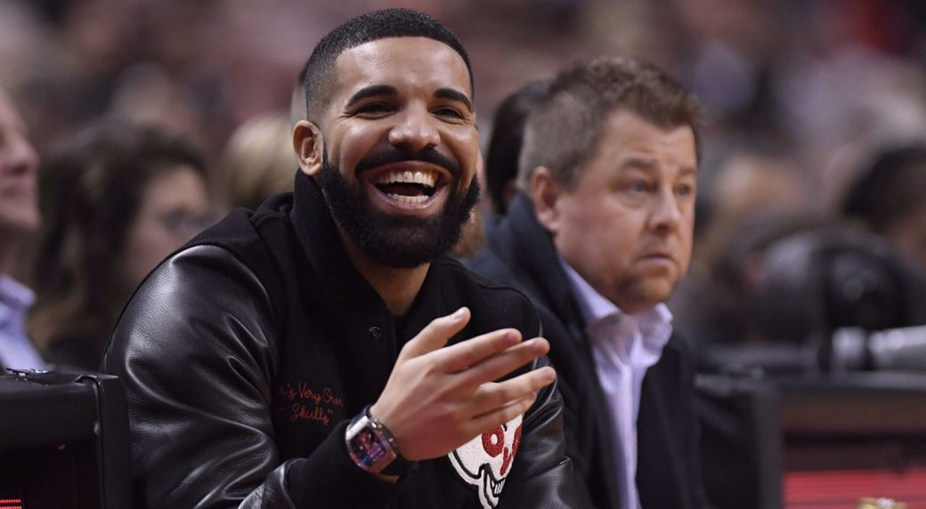 2261853a Drake smiles as he watches the Raptors play the Golden State Warriors.  (Nathan Denette/CP)