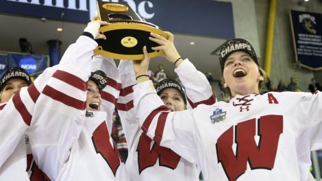 Wisconsin's-Emily-Clark-raises-the-NCAA-National-Championship-trophy