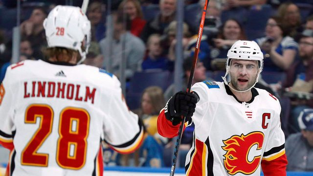 Flames-Giordano-celebrates-goal-with-Lindholm