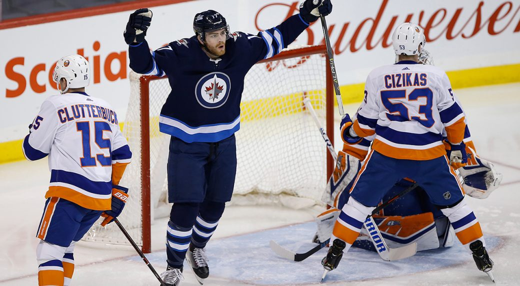 410ec75b3c0 Winnipeg Jets' Adam Lowry (17) celebrates his goal on New York Islanders  goaltender Robin Lehner (40) 13 seconds into the first period of NHL action  in ...