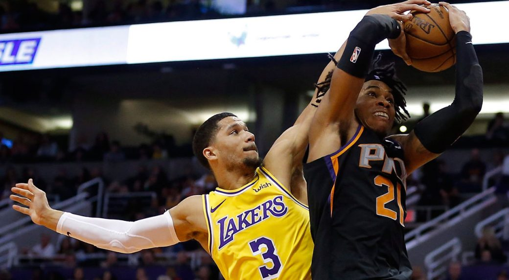 b545a527eba Los Angeles Lakers guard Josh Hart (3) blocks the shot on Phoenix Suns  forward Richaun Holmes during the second half of an NBA basketball game.