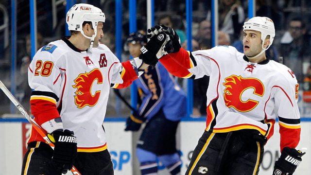 NHL-Flames-Regehr-celebrates-goal-with-Giordano