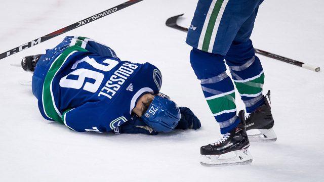 antoine-roussel-lays-on-ice-injured